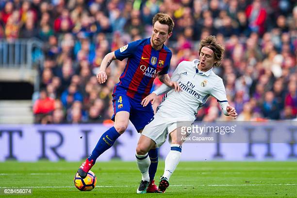 Ivan Rakitic of FC Barcelona fights for the ball with Luka Modric of Real Madrid CF during the La Liga match between FC Barcelona and Real Madrid CF...