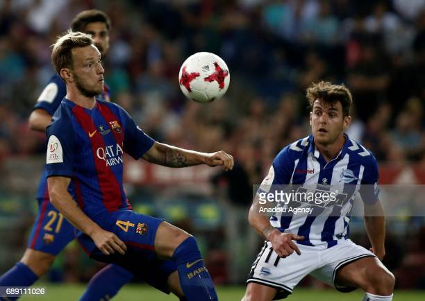 Ivan Rakitic of FC Barcelona in action against Ibai Gomez of Deportivo Alaves during the Copa Del Rey Final between FC Barcelona and Deportivo Alaves...