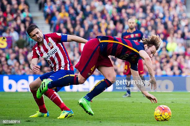 Ivan Rakitic of FC Barcelona is brought down by Gabi Fernandez of Club Atletico de Madrid during the La Liga match between FC Barcelona and Club...