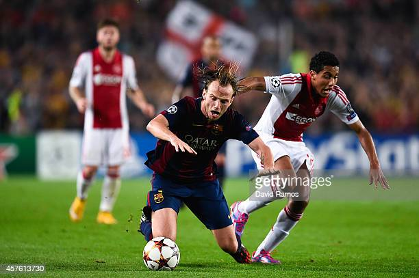 Ivan Rakitic of FC Barcelona is brought down by Jairo Riedewald of AFC Ajax during a UEFA Champions League Group F match between FC Barcelona and AFC...