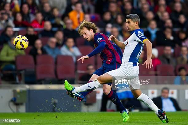 Ivan Rakitic of FC Barcelona plays the ball close to Salva Sevilla of RCD Espanyol during the La Liga match between FC Barcelona and RCD Espanyol at...
