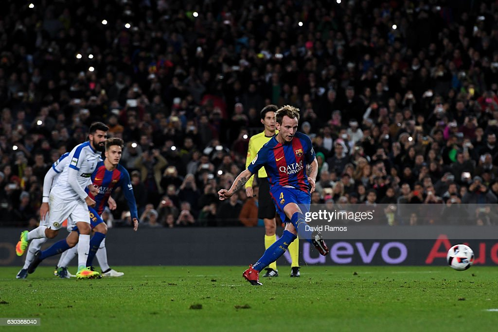 Ivan Rakitic of FC Barcelona scores from the penalty spot his team's second goal during the Copa del Rey round of 32 second leg match between FC Barcelona and Hercules at Camp Nou on December 21, 2016 in Barcelona, Spain.