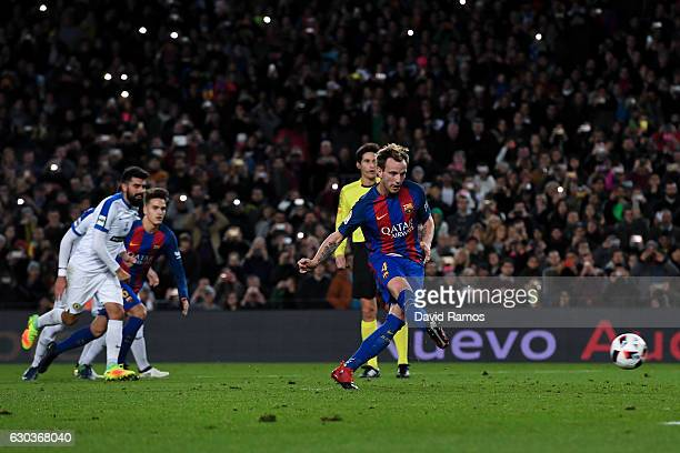 Ivan Rakitic of FC Barcelona scores from the penalty spot his team's second goal during the Copa del Rey round of 32 second leg match between FC...