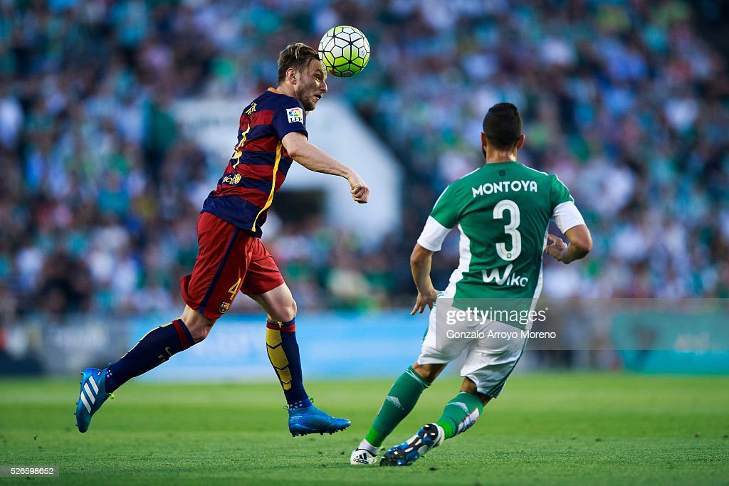 <a gi-track='captionPersonalityLinkClicked' href=/galleries/search?phrase=Ivan+Rakitic&family=editorial&specificpeople=3987920 ng-click='$event.stopPropagation()'>Ivan Rakitic</a> of FC Barcelona wins the header before Martin Montoya of Real Betis Balompie during the La Liga match between Real Betis Balompie and FC Barcelona at Estadio Benito Villamarin on April 30, 2016 in Seville, Spain.