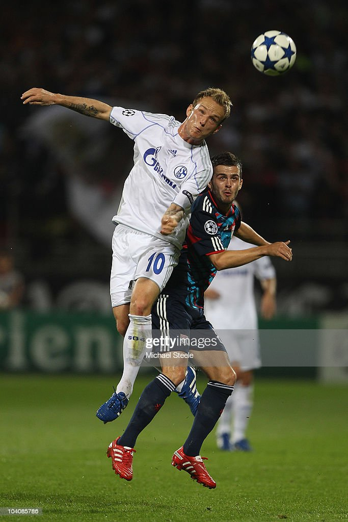 <a gi-track='captionPersonalityLinkClicked' href=/galleries/search?phrase=Ivan+Rakitic&family=editorial&specificpeople=3987920 ng-click='$event.stopPropagation()'>Ivan Rakitic</a> (L) of Schalke outjumps <a gi-track='captionPersonalityLinkClicked' href=/galleries/search?phrase=Miralem+Pjanic&family=editorial&specificpeople=4586190 ng-click='$event.stopPropagation()'>Miralem Pjanic</a> of Lyon during the UEFA Champions League Group B match between Olympique Lyonnais and FC Schalke 04 at the Stade de Gerland on September 14, 2010 in Lyon, France.