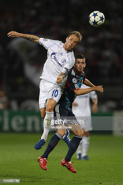 Ivan Rakitic of Schalke outjumps Miralem Pjanic of Lyon during the UEFA Champions League Group B match between Olympique Lyonnais and FC Schalke 04...