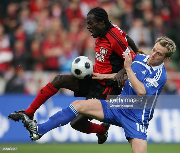 Ivan Rakitic of Schalke tackles Hans Sarpei of Leverkusen during the Bundesliga match between Bayer Leverkusen and Schalke 04 at the BayArena on...