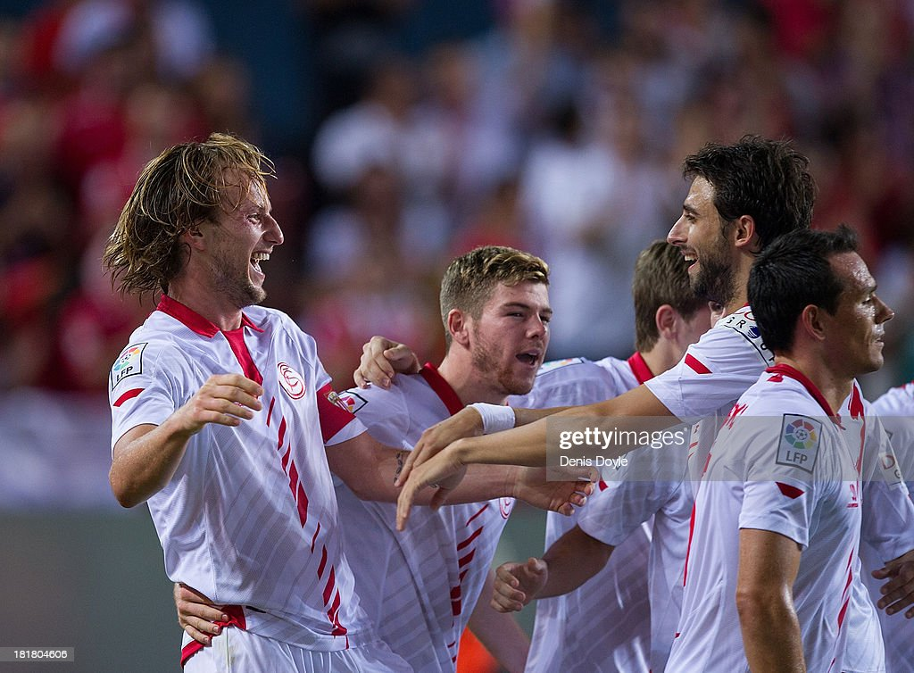 <a gi-track='captionPersonalityLinkClicked' href=/galleries/search?phrase=Ivan+Rakitic&family=editorial&specificpeople=3987920 ng-click='$event.stopPropagation()'>Ivan Rakitic</a> (L) of Sevilla FC celebrates after scoring Sevilla 2nd goal during the La liga match between Sevilla FC and Rayo Vallecano de Madrid at Estadio Ramon Sanchez Pizjuan on September 25, 2013 in Seville, Spain.