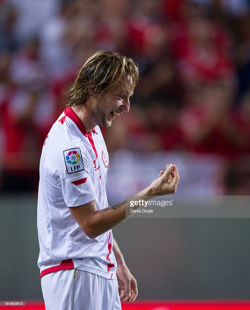 <a gi-track='captionPersonalityLinkClicked' href=/galleries/search?phrase=Ivan+Rakitic&family=editorial&specificpeople=3987920 ng-click='$event.stopPropagation()'>Ivan Rakitic</a> of Sevilla FC celebrates after scoring Sevilla 2nd goal during the La liga match between Sevilla FC and Rayo Vallecano de Madrid at Estadio Ramon Sanchez Pizjuan on September 25, 2013 in Seville, Spain.