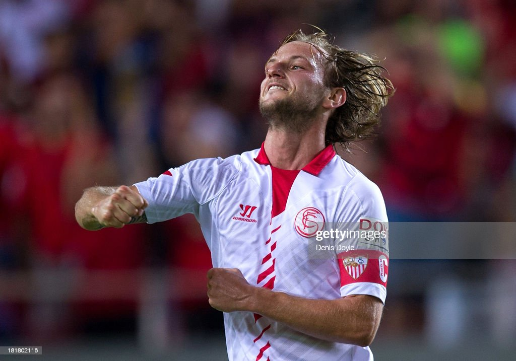 <a gi-track='captionPersonalityLinkClicked' href=/galleries/search?phrase=Ivan+Rakitic&family=editorial&specificpeople=3987920 ng-click='$event.stopPropagation()'>Ivan Rakitic</a> of Sevilla FC celebrates after scoring Sevilla's second goal during the La liga match between Sevilla FC and Rayo Vallecano de Madrid at Estadio Ramon Sanchez Pizjuan on September 25, 2013 in Seville, Spain.