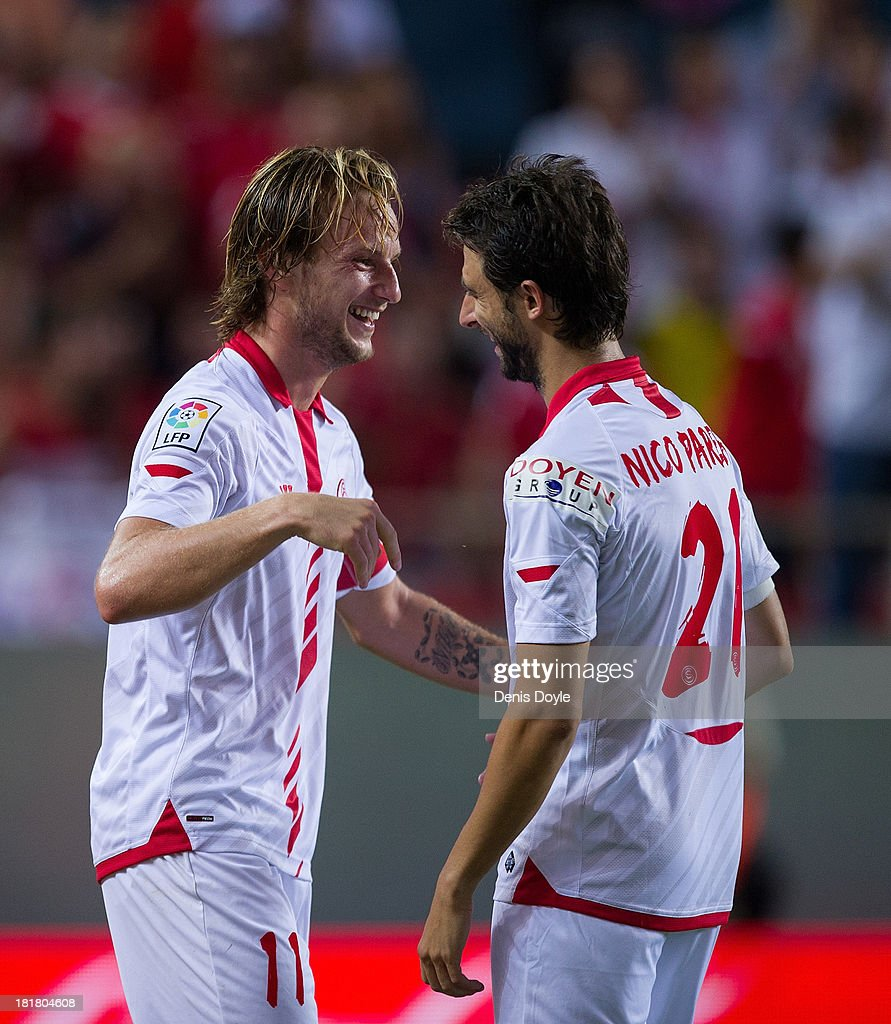 <a gi-track='captionPersonalityLinkClicked' href=/galleries/search?phrase=Ivan+Rakitic&family=editorial&specificpeople=3987920 ng-click='$event.stopPropagation()'>Ivan Rakitic</a> (L) of Sevilla FC celebrates with Nico Pareja after scoring Sevilla 2nd goal during the La liga match between Sevilla FC and Rayo Vallecano de Madrid at Estadio Ramon Sanchez Pizjuan on September 25, 2013 in Seville, Spain.