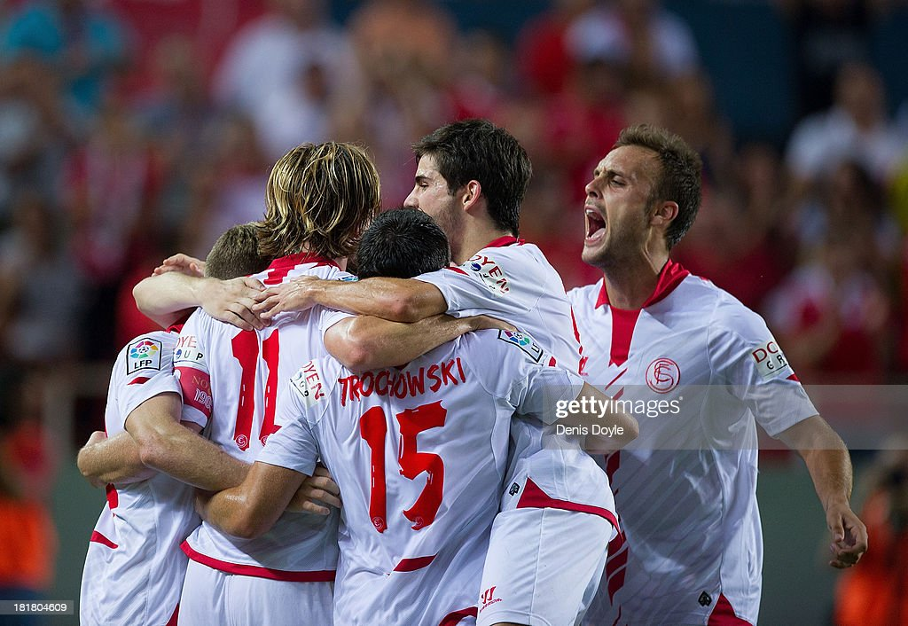 <a gi-track='captionPersonalityLinkClicked' href=/galleries/search?phrase=Ivan+Rakitic&family=editorial&specificpeople=3987920 ng-click='$event.stopPropagation()'>Ivan Rakitic</a> (#11) of Sevilla FC celebrates with <a gi-track='captionPersonalityLinkClicked' href=/galleries/search?phrase=Piotr+Trochowski&family=editorial&specificpeople=635014 ng-click='$event.stopPropagation()'>Piotr Trochowski</a> (#15) and Juan torres 'Cala' after scoring Sevilla's 2nd goal during the La liga match between Sevilla FC and Rayo Vallecano de Madrid at Estadio Ramon Sanchez Pizjuan on September 25, 2013 in Seville, Spain.