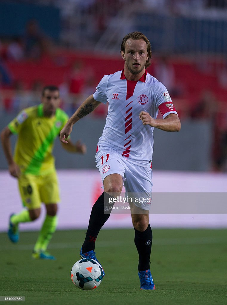 <a gi-track='captionPersonalityLinkClicked' href=/galleries/search?phrase=Ivan+Rakitic&family=editorial&specificpeople=3987920 ng-click='$event.stopPropagation()'>Ivan Rakitic</a> of Sevilla FC in action during the La liga match between Sevilla FC and Rayo Vallecano de Madrid at Estadio Ramon Sanchez Pizjuan on September 25, 2013 in Seville, Spain.