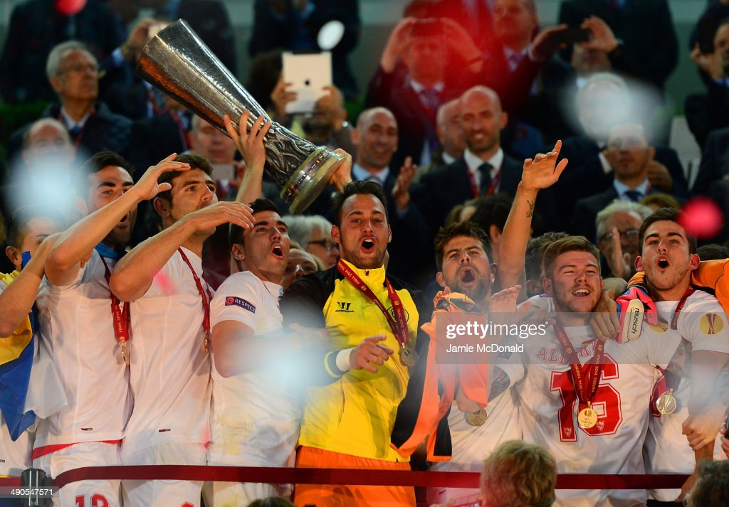 Ivan Rakitic of Sevilla lifts the Europa League trophy during the UEFA Europa League Final match between Sevilla FC and SL Benfica at Juventus...