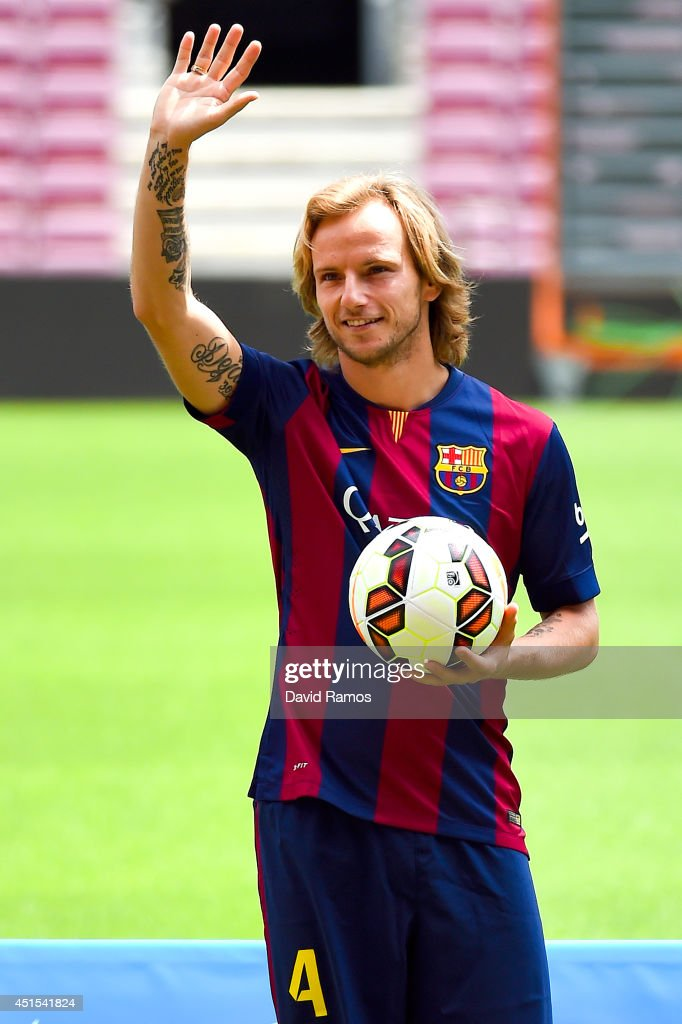 <a gi-track='captionPersonalityLinkClicked' href=/galleries/search?phrase=Ivan+Rakitic&family=editorial&specificpeople=3987920 ng-click='$event.stopPropagation()'>Ivan Rakitic</a> poses as a new player for FC Barcelona at the Camp Nou stadium on July 1, 2014 in Barcelona, Spain.