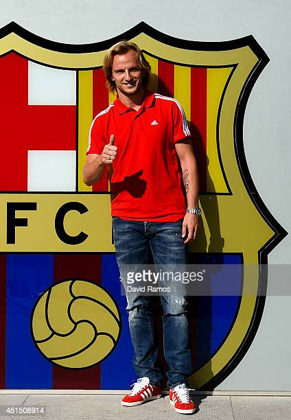 Ivan Rakitic poses before signing as a new player for FC Barcelona at the Camp Nou sport complex on June 30 2014 in Barcelona Spain