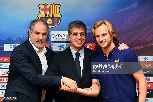 Ivan Rakitic poses with the FC Barcelona Sport Director Andoni Zubizarreta and FC Barcelona VicePresident Jordi Mestre during the presentation as a...