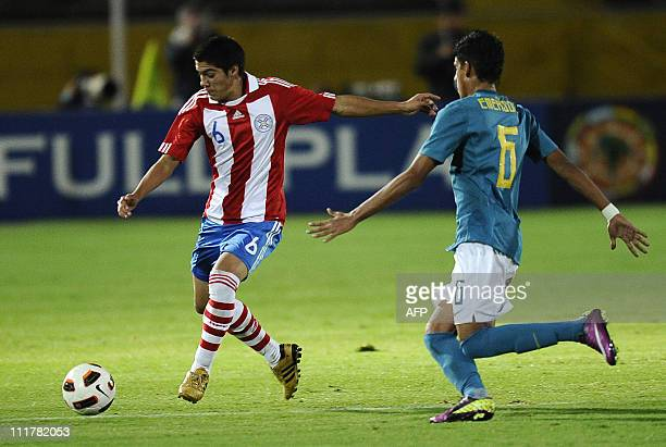 Ivan Ramirez from Paraguay vies for ball with Emerson from Brazil during their Copa Sudamericana U17 football match at the Atahualpa Stadium in Quito...