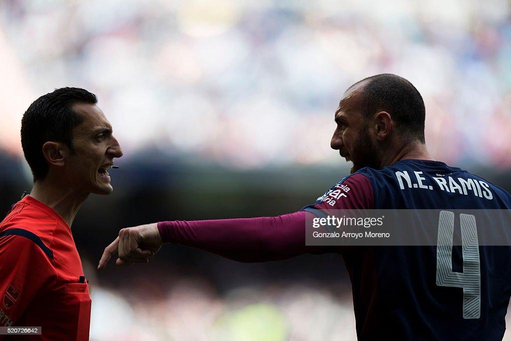 Ivan Ramis of SD Eibar argues with referee Jose Maria Sanchez Martinez during the La Liga match between Real Madrid CF and SD Eibar at Estadio...