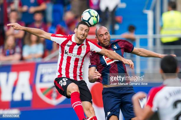 Ivan Ramis of SD Eibar duels for the ball with Aritz Aduriz of Athletic Club during the La Liga match between SD Eibar and Athletic Club Bilbao at...