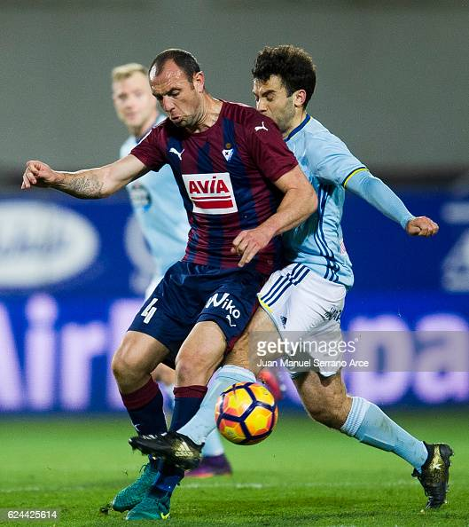 Ivan Ramis of SD Eibar duels for the ball with Giuseppe Rossi of RC Celta de Vigo during the La Liga match between SD Eibar and RC Celta de Vigo at...