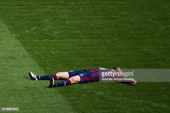Ivan Ramis of SD Eibar reacts lied on the grass during the La Liga match between Real Madrid CF and SD Eibar at Estadio Santiago Bernabeu on April 9...