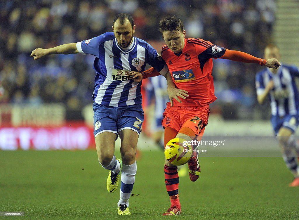 Ivan Ramis of Wigan Athletic and Joe Mason of Bolton Wanderers battle for the ball during the Sky Bet Championship match between Wigan Athletic and...