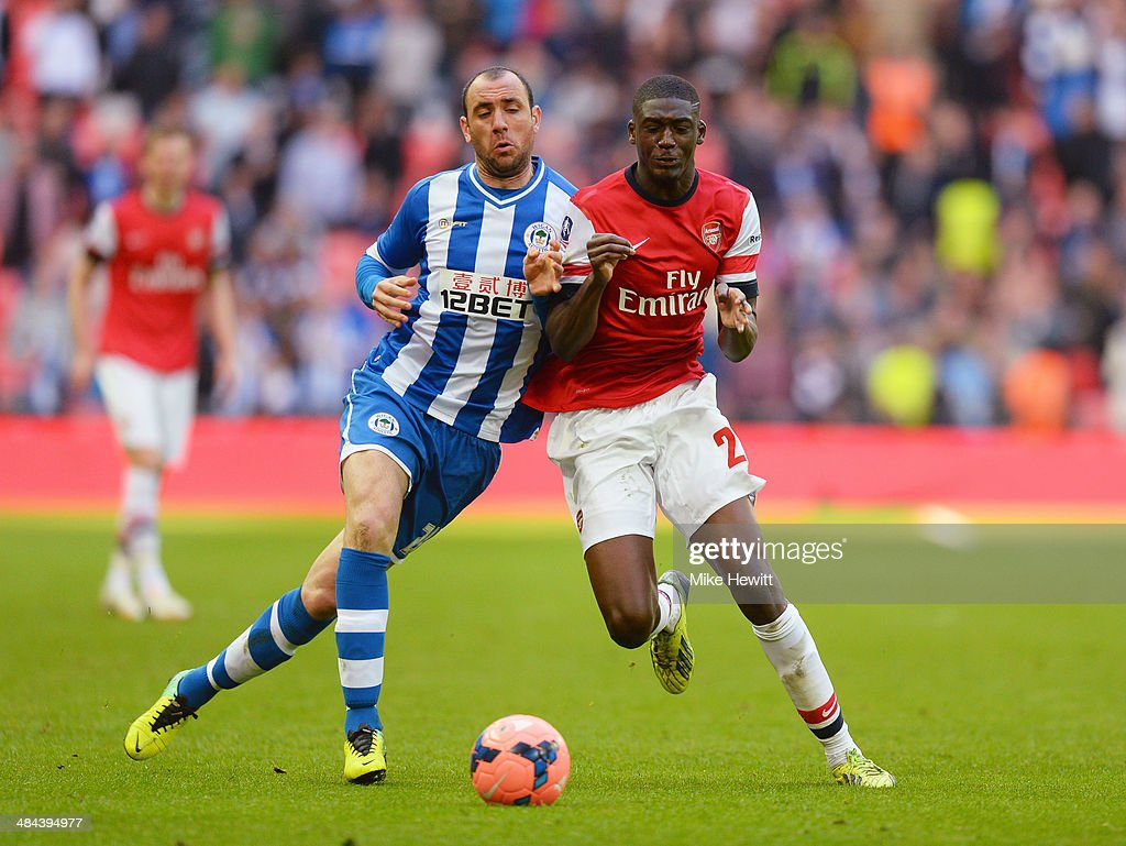 Ivan Ramis of Wigan Athletic and Yaya Sanogo of Arsenal compete for the ball during the FA Cup SemiFinal match between Wigan Athletic and Arsenal at...