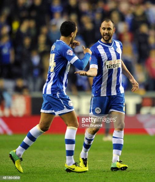 Ivan Ramis of Wigan Athletic is congratulated by teammate James Perch after scoring the opening goal during the Sky Bet Championship match between...
