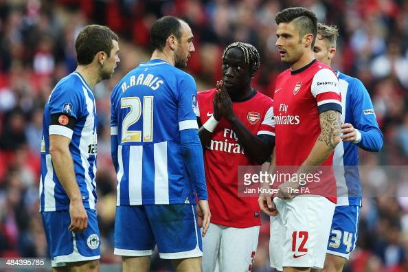 Ivan Ramis of Wigan Athletic remonstrates with Olivier Giroud of Arsenal during the FA Cup SemiFinal match between Wigan Athletic and Arsenal at...