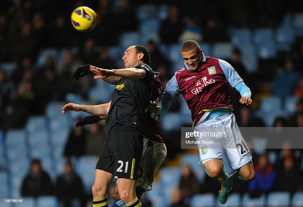 Ivan Ramis of Wigan battles with Jordan Bowery of Villa during the Barclays Premier League match between Aston Villa and Wigan Athletic at Villa Park on December 29, 2012 in Birmingham, England.