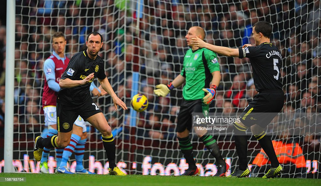 Ivan Ramis of Wigan celebrates scoring to make it 1-0 with team mate Gary Caldwell during the Barclays Premier League match between Aston Villa and Wigan Athletic at Villa Park on December 29, 2012 in Birmingham, England.