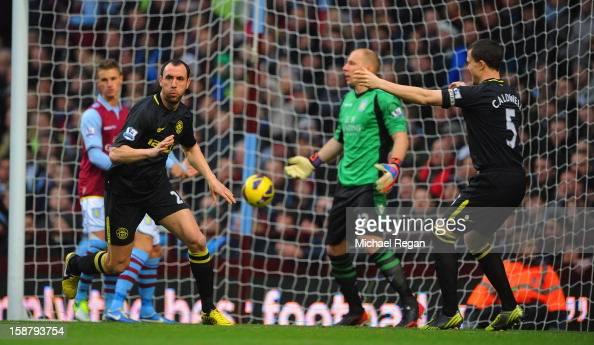 Ivan Ramis of Wigan celebrates scoring to make it 10 with team mate Gary Caldwell during the Barclays Premier League match between Aston Villa and...