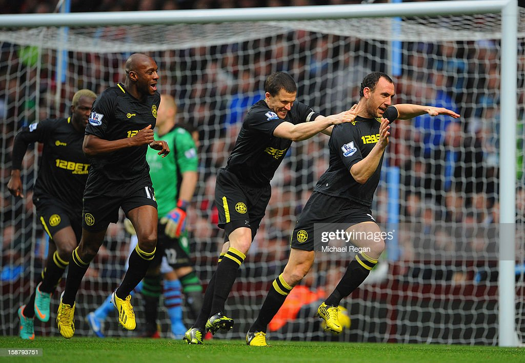 Ivan Ramis (R) of Wigan celebrates scoring to make it 1-0 with team mates Gary Caldwell (C) and Emmerson Boyce during the Barclays Premier League match between Aston Villa and Wigan Athletic at Villa Park on December 29, 2012 in Birmingham, England.