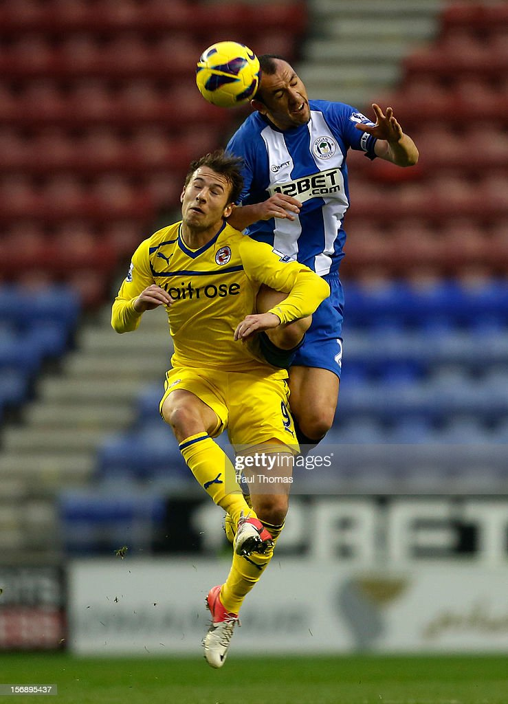 Ivan Ramis of Wigan in action with Adam Le Fondre of Reading during the Barclays Premier League match between Wigan Athletic and Reading at the DW...