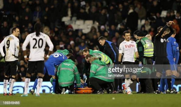 Ivan Ramis of Wigan receives medical treatment before being stretchered off the pitch during the Barclays Premier League match between Fulham and...