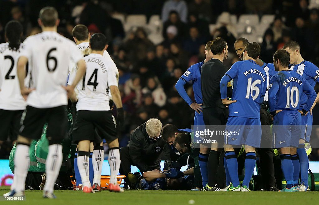 Ivan Ramis of Wigan receives medical treatment before being stretchered off the pitch during the Barclays Premier League match between Fulham and Wigan Athletic at Craven Cottage on January 12, 2013 in London, England.