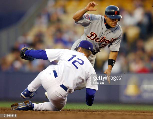 Ivan Rodriguez of the Detroit Tigers is tagged out at second base by Jeff Kent of the Los Angeles Dodgers The Tigers defeated the Dodgers 84 at...