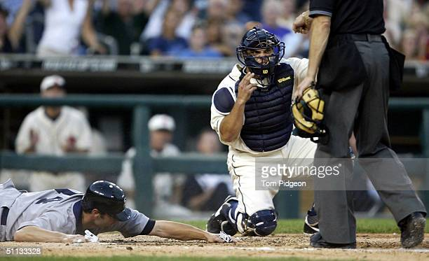 Ivan Rodriguez of the Detroit Tigers looks towards Umpire Bill Hohn as he calls out Paul Konerko of the Chicago White Sox in the 6th inning on a...