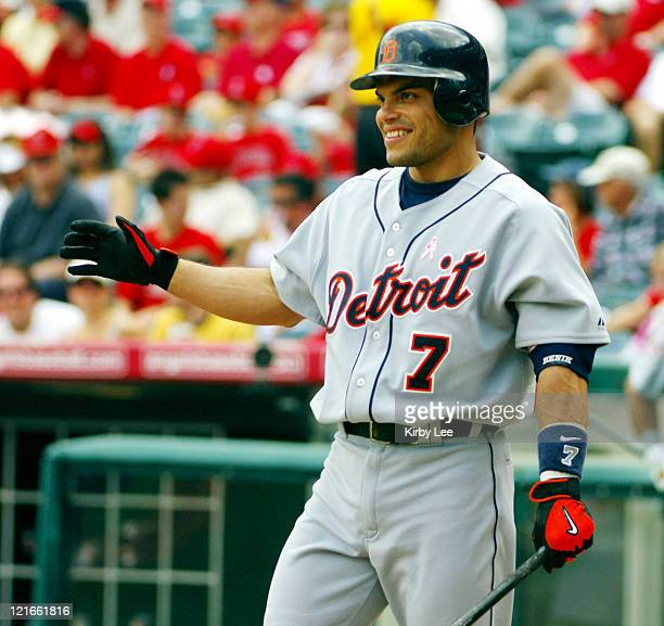 Ivan Rodriguez of the Detroit Tigers waits at home plate to greet Brandon Inge after a leadoff home run in 101 victory over the Los Angeles Angels of...