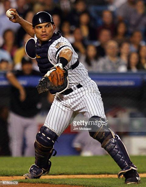 Ivan Rodriguez of the New York Yankees throws to first base for an out against the Chicago White Sox on September 17 2008 at Yankee Stadium in the...