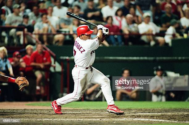 Ivan Rodriguez of the Texas Rangers bats against the Los Angeles Angels of Anaheim at Rangers Ballpark in Arlington on April 9 1999 in Arlington...