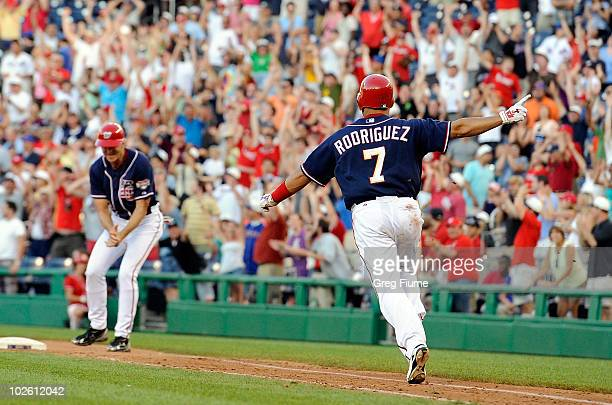 Ivan Rodriguez of the Washington Nationals celebrates after driving in the game winning run in the ninth inning against the New York Mets at...