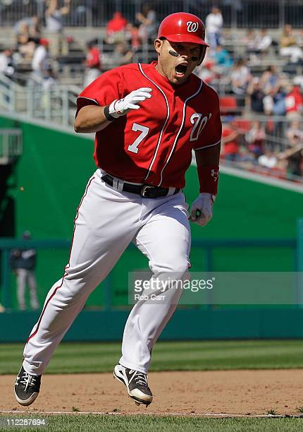 Ivan Rodriguez of the Washington Nationals celebrates while rounding the bases after hitting a three run home run against the Milwaukee Brewers in...