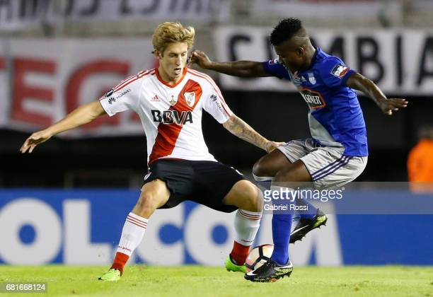 Ivan Rossi of River Plate fights for the ball with Carlos Moreno of Emelec during a group stage match between River Plate and Emelec as part of Copa...