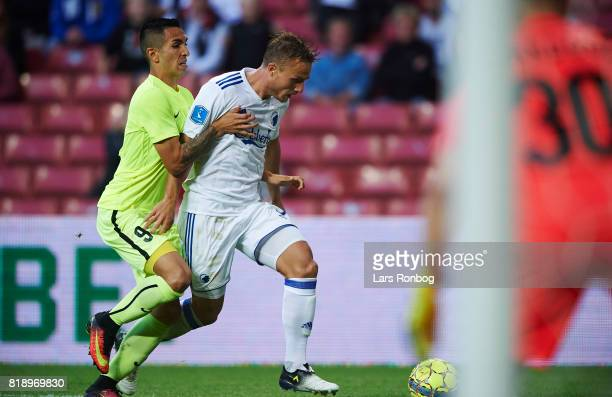 Ivan Santiago Diaz of MSK Zilina and Pierre Bengtsson of FC Copenhagen compete for the ball during the UEFA Champions League Qualification match...