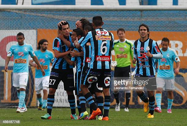 Ivan Santillan of Real Garcilaso celebrates with his teammates after scoring the first goal of his team during a match between Sporting Cristal and...