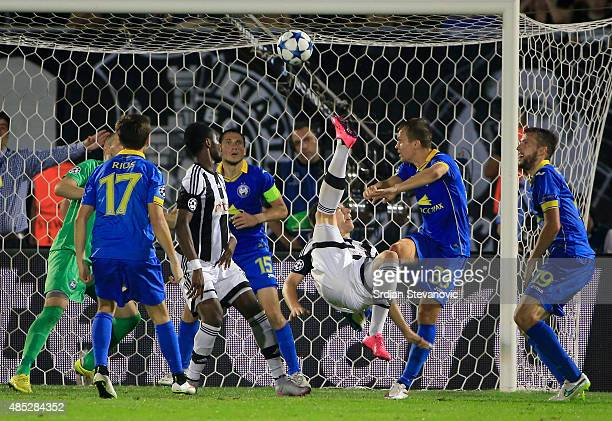 BELGRADE SERBIA AUGUST 26 Ivan Saponjic of Partizan Belgrade scores the goal near Denis Polyakov of BATE during the UEFA Champions League Qualifying...
