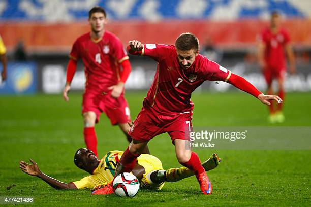 Ivan Saponjic of Serbia is tackled by Souleymane Coulibaly of Mali during the FIFA U20 World Cup Semi Final match between Serbia and Mali at North...