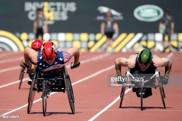 Ivan Sears of the United States and Andrew Bracey of the United Kingdom compete in the Men's IT4 100m Final during the Invictus Games 2017 at York...